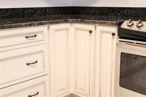 handles for kitchen cabinet doors white cabinetry with hardware knob on lazy susan