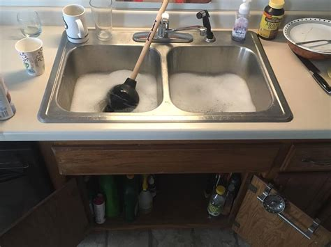 kitchen sink backing up services a s a p sewer and drain cleaning