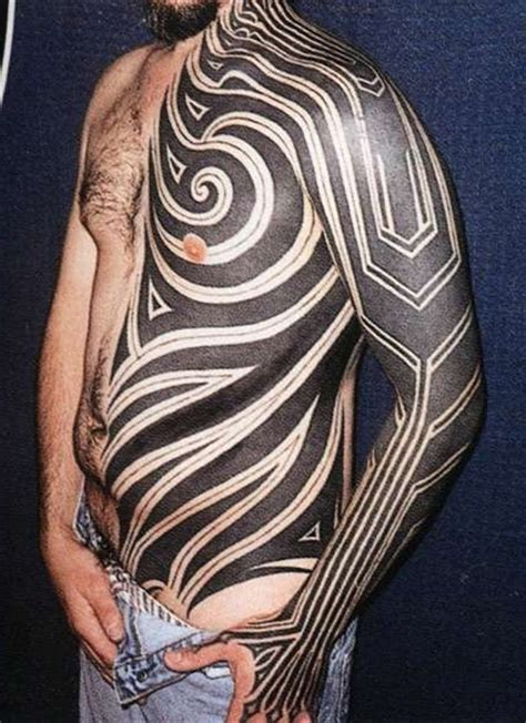 blackwork half of body tribal tattoo