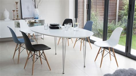 White Oval Dining Table Uk by Ellie Oval Extending And Eames Style Dining Set