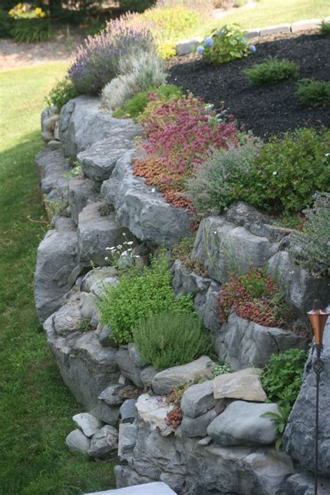 rock wall garden ideas 25 best ideas about sloped front yard on