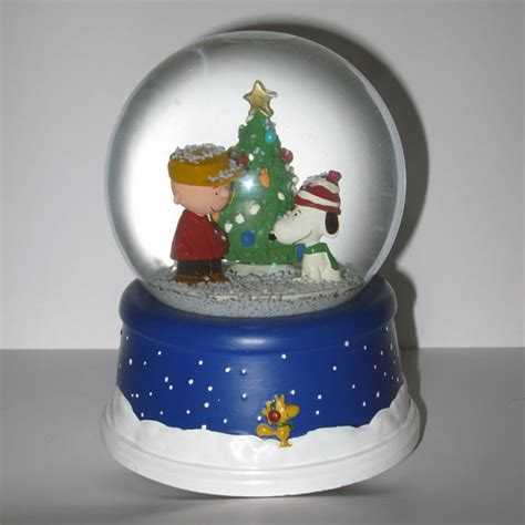 peanuts musical decorations peanuts 50th anniversary musical snow globe