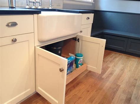 kitchen sink pull out storage custom white cabinets with farmhouse sink pull out