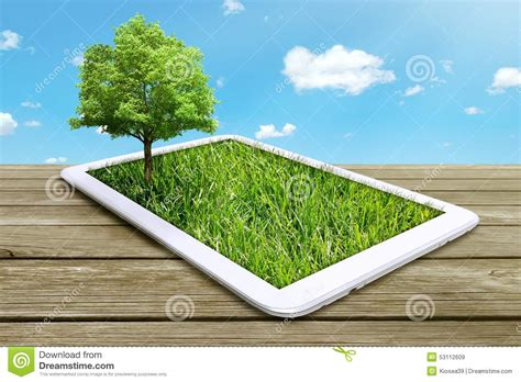 computer tree tablet computer with green grass and tree stock photo
