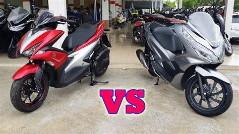 Pcx 2018 Vs Aerox by New Honda Pcx 150 Vs Yamaha Aerox 155