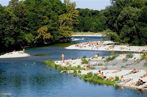 Englischer Garten München Flaucher by Sunbathing At The Banks Of The River Isar
