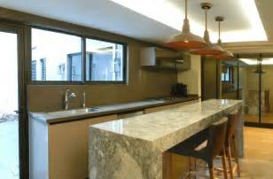 pendant lights above kitchen island renovated mexican residence with a home office and a