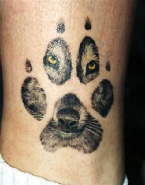 cool wolf paw amp face tattoo