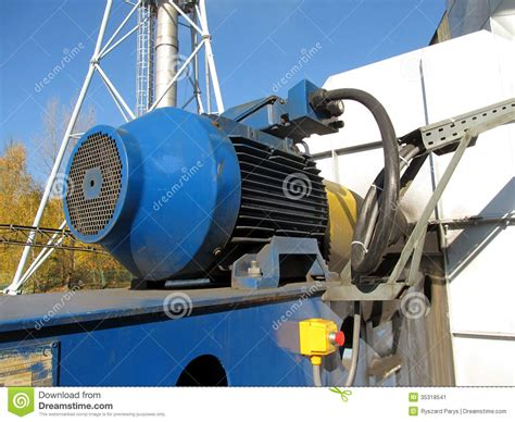 Large Electric Motor by Large Electric Motor Of Blue Color As The Drive To The Fan