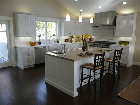 white kitchen cabinets with island kitchen black wooden floor simple chandelier white