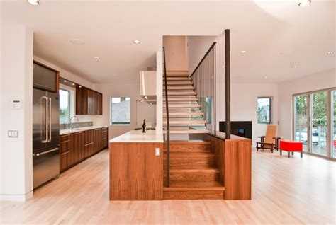 Center Hall Colonial Open Floor Plan modern stair by build llc modern staircase seattle