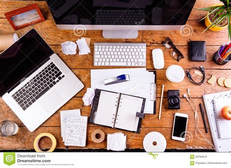 lay computer desk desk with various gadgets and office supplies flat lay