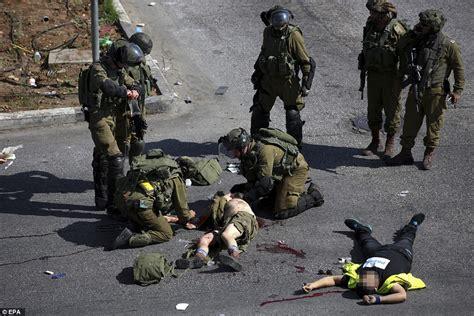 for soldiers israeli trooper lies wounded beside palestinian knifeman