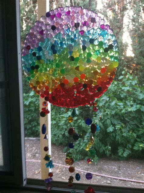 how to make suncatchers with plastic melted pony bead suncatcher by l kalama fyi melting the