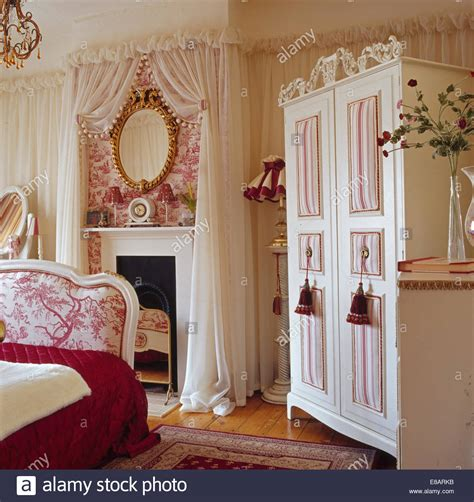 toile bedroom wardrobe in bedroom with voile drapes on walls