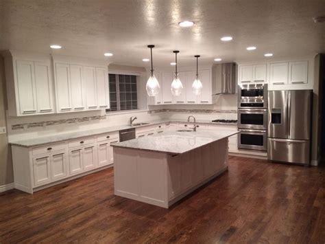 hardwood kitchen cabinets white cabinets hardwood floors look at those floors