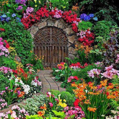 secret garden flowers beautiful gate in garden and oh my what a garden