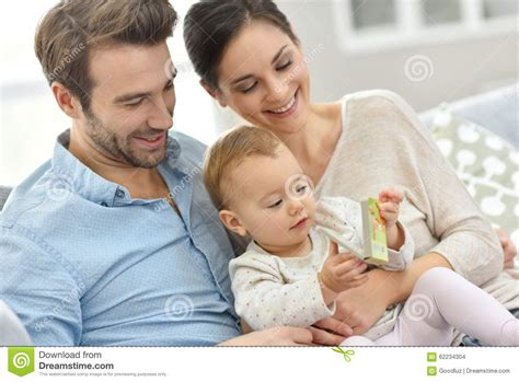 family picture book for baby portrait of happy family with baby reading child s book