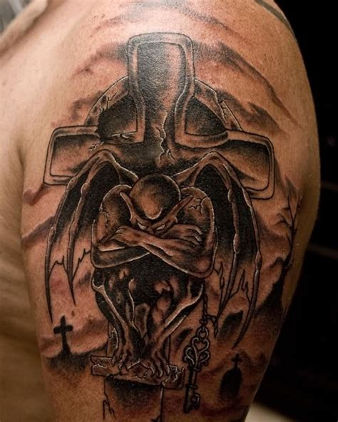 sad gargoyle with stone cross tattoo tattooimages biz