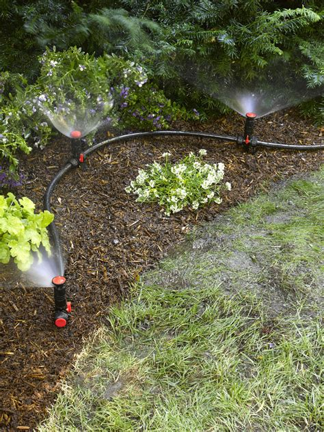 watering vegetable garden with sprinklers above ground irrigation systems for landscaping diy