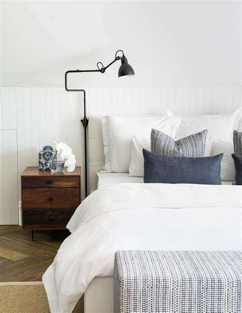 beadboard in bedroom bedroom with sloped ceiling and beadboard walls