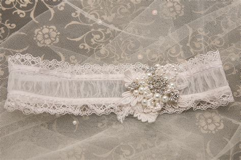 lace rhinestones and such shear wedding garter with lace rhinestones and pearls