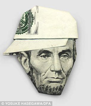 five dollar bill origami gandhi in a baseball cap and the in a turban it