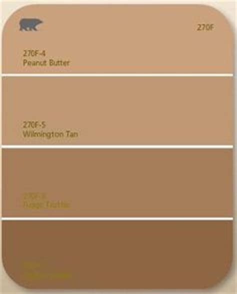 behr paint colors melted butter behr paint chips i like status bronze for front