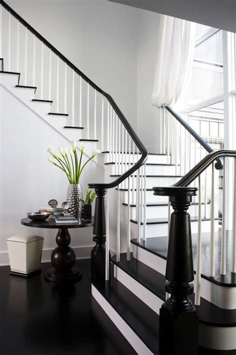 black staircase black stair railing transitional entrance foyer lda