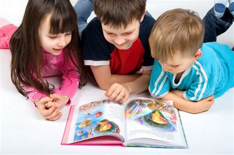 child reading book picture pediaspeech reading to children
