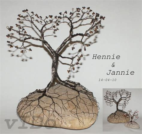 how to make a wire jewelry tree two twisted wire trees entwined trees and water and