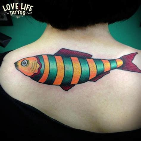 new back fish tattoo by love life tattoo