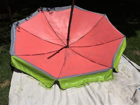 spray paint umbrella paint a watermelon pattern on your outdoor umbrella