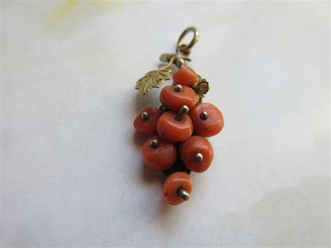 antique coral antique coral charm from inspiredbynanny on ruby