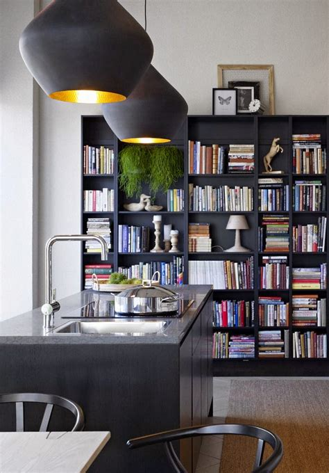 black bookshelves decorating the kitchen with bookshelves