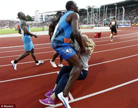 Usain Bolt Crash by Usain Bolt Sets Crashes Into Flower At End Of 100m