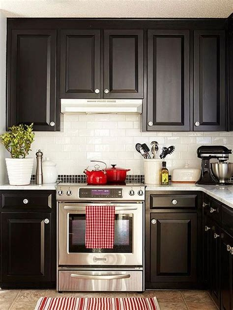 pictures of kitchens with white cabinets and black appliances one color fits most black kitchen cabinets
