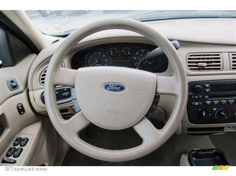 all car manuals free 2006 ford taurus interior lighting 2006 ford taurus se medium dark pebble beige steering wheel photo 59391476 gtcarlot com