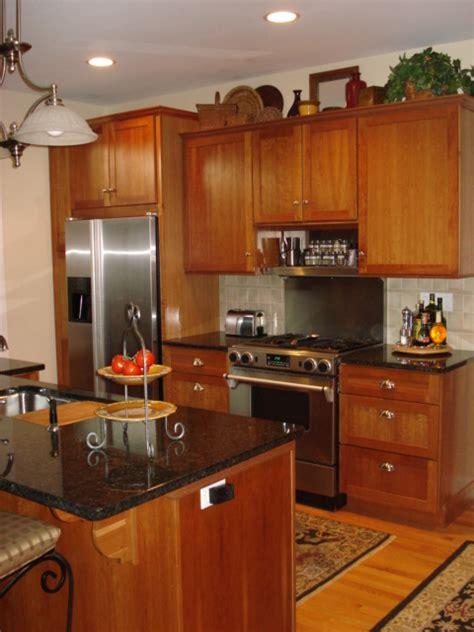 honey oak kitchen cabinets honey oak kitchen cabinets with black countertops