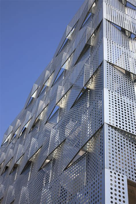 Brick Garages Designs perforated building facades that redefine traditional design