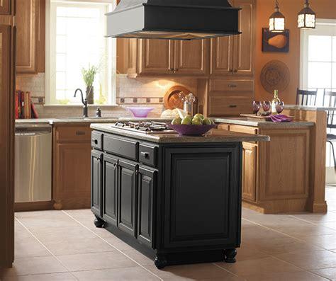 kitchen islands oak light oak cabinets with a black kitchen island masterbrand
