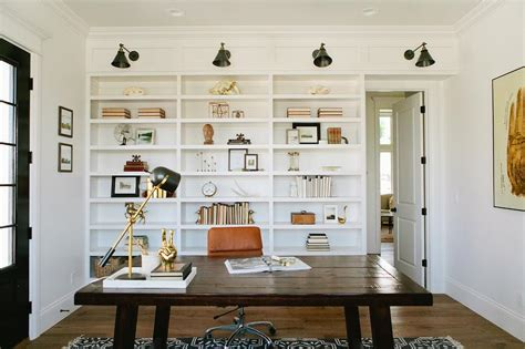 single bookshelves built in bookcase with swing arm sconces cottage den