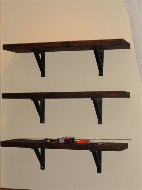 black shelves wall rustic wall mount shelving unit on white painted wall for