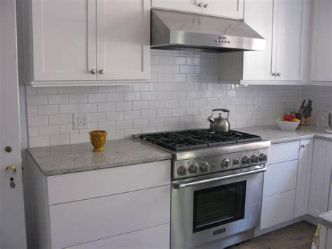 subway tile backsplash in kitchen kitchen kitchen glass white subway tile backsplash ideas hoods wooden flooring gas stove and