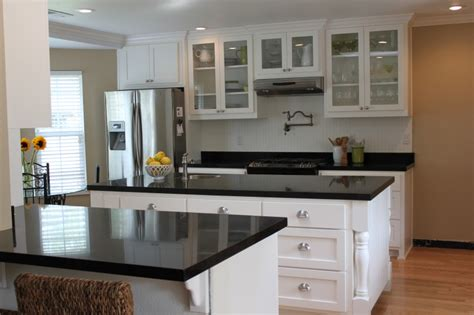 white kitchen cabinets with black granite countertops
