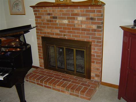 fireplace glass doors open or closed how to make a fireplace more efficient