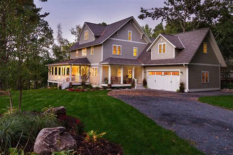 farmhouse style house charming lakeside farmhouse nestled on a wooded site in minnesota
