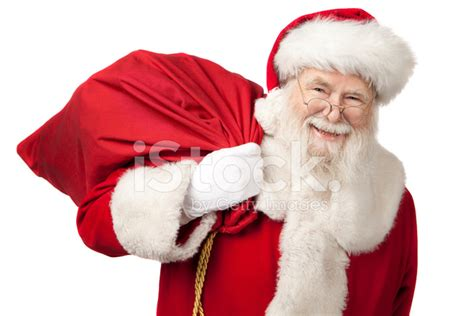santa claus pictures of real santa claus carrying a gift bag stock