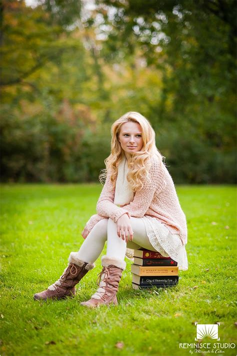 senior pictures with books high school senior sitting on top of books lake park