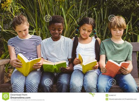 free children s books with audio and pictures children reading books at park stock photo image 50486147